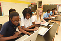 Eighth graders work on computers at the International School of Louisiana in New Orleans, Friday, Aug. 28, 2015.