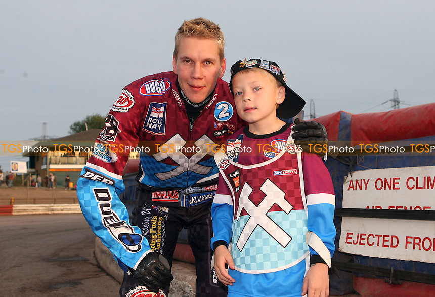 Kauko Nieminen of Lakeside Hammers with the meeting's mascot - Lakeside Hammers vs Poole Pirates, Elite League Speedway at the Arena Essex Raceway, Purfleet - 06/05/11 - MANDATORY CREDIT: Rob Newell/TGSPHOTO - Self billing applies where appropriate - 0845 094 6026 - contact@tgsphoto.co.uk - NO UNPAID USE.