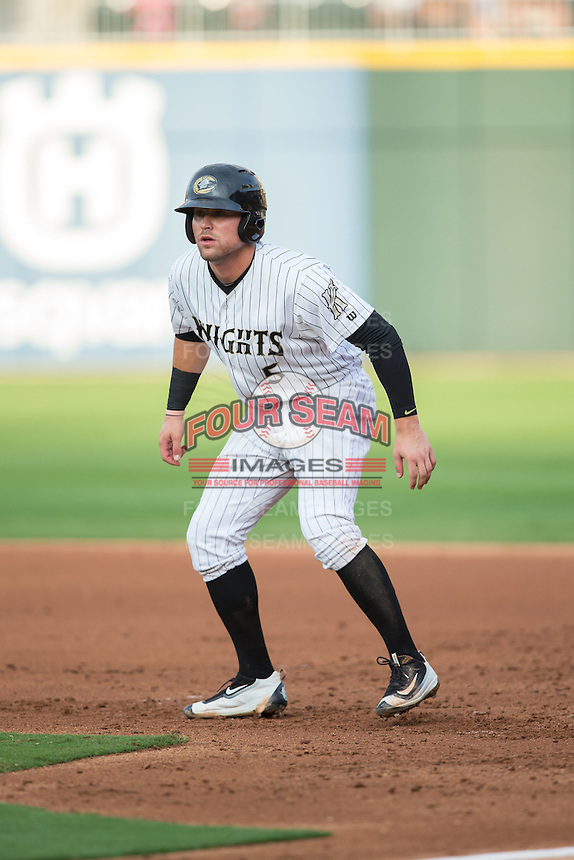 Jake Peter (5) of the Charlotte Knights takes his lead off of first base against the Pawtucket Red Sox at BB&T BallPark on July 6, 2016 in Charlotte, North Carolina.  The Knights defeated the Red Sox 8-6.  (Brian Westerholt/Four Seam Images)