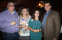 NWA Democrat-Gazette/CARIN SCHOPPMEYER Chris and Kathleen Burgess (from left) and Veronica and Blake Foster visit at Read Between the Wines on Sept. 16.