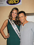 "Andrea Rogers (Miss West Virginia USA) poses with General Hospital's Scott Reeves ""Dr. Steven Lars Webber"" at the Celebrity Grand Marshal at the 33rd Annual Mountain State Apple Harvest Festival (MSAHF) 2012 on October 20, 2012 at the Bob Elmer Celebrity Sports Breakfast sponsored by the Rotary Clubl in Martinsburg, West Virginia. (Photo by Sue Coflin/Max Photos)"