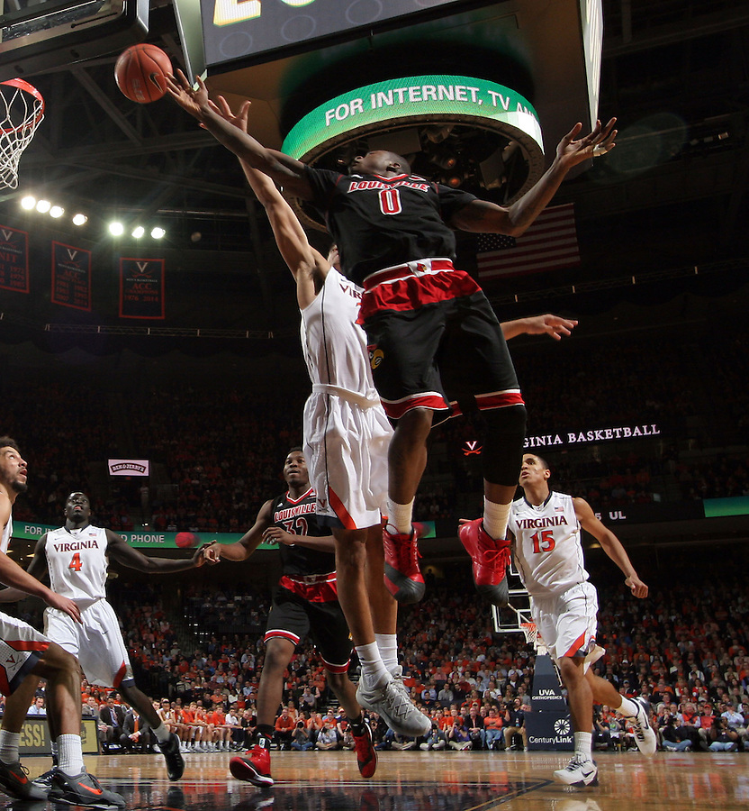 Louisville guard Terry Rozier (0) shoots in front of Virginia guard Malcolm Brogdon (15) during the second half of an NCAA basketball game Saturday Feb. 7, 2015, in Charlottesville, Va. Virginia defeated Louisville  52-47. (Photo/Andrew Shurtleff)