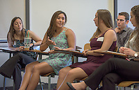 """Professor Marcella Raney, left, listens as Zoe Namba '16 talks about """"The Impact of Wellness Workshops on the Nutrition Knowledge and Behavior of Occidental College Hourly Staff.""""  Erin Van Zanten '17 is to the right. After researching all summer, Occidental College students present their work at the annual Summer Undergraduate Research Conference on July 29, 2015.<br /> (Photo by Marc Campos, Occidental College Photographer)"""