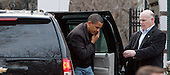 Chicago, IL - February 15, 2009 -- United States President Barack Obama exits his motorcade and walks to a friends house to watch the NBA All-Star basketball game February 15, 2009, in Chicago, Illinois. .Credit: Frank Polich - Pool via CNP