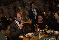 Peter Zhang (with mike) and  Matthew Walsh, Town Mayor & Chairman, Princes Risborough Town Council, at a party with members of the Chinese-UK Business Alliance in The Plough at Cadsden, Buckinghamshire. SinoFortone Group bought the pub after it was visited by Chinese Premiere Ji Jinping last year, and aim to develop  a chain of English-style pubs China.<br /> <br /> Photo by Richard Jones