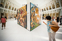 """Near life-size reproductions of Michelangelo's Sistine Chapel frescoes are seen on display in the Oculus in the World Trade Center Transportation Hub in New York on Thursday, June 22, 2017.  Entitled """"Up Close: Michelangelo's Sistine Chapel"""" the 34 copies allow visitors to get up close and personal with the Florentine artist's masterpieces with the centerpiece being """"The Last Judgement"""" which in Vatican City takes over the altar wall of the Sistine Chapel. The display will be on view until July 23 when it is packed up and travels to other malls. (© Richard B. Levine)"""