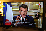 Paris, March 12, 2020, a TV screen broadcasting the declaration of France's President Emmanuel Macron, made from The Elysee Palace, about the situation of the COVID-19 outbreak, caused by the novel coronavirus. Emmanuel Macron announced schools in France would close from next Monday and urged people over 70 to stay at home, to curb the spread of the coronavirus. French president also announced that local elections to be held on March 15, will not be postponed.