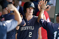 Ryan Fitzgerald (24) of the Greenville Drive is greeted in the dugout after scoring a run in Game 1 of a doubleheader against the Rome Braves on Friday, August 3, 2018, at Fluor Field at the West End in Greenville, South Carolina. Rome won, 7-6. (Tom Priddy/Four Seam Images)
