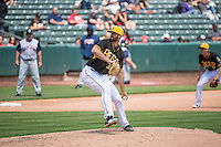 Scott Snodgress (36) of the Salt Lake Bees delivers a pitch to the plate against the Colorado Springs Sky Sox in Pacific Coast League action at Smith's Ballpark on May 24, 2015 in Salt Lake City, Utah.  (Stephen Smith/Four Seam Images)