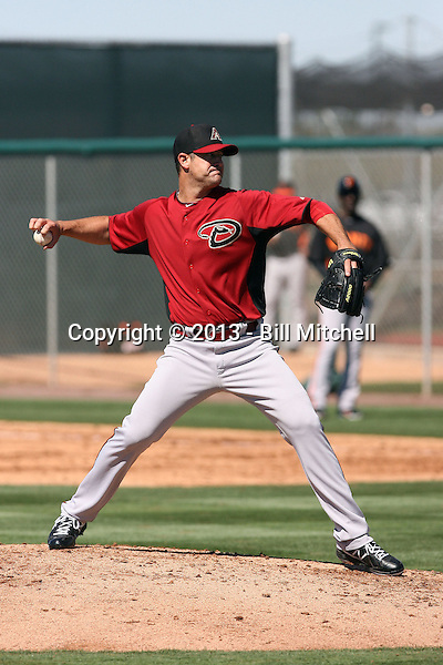"Josh Booty, winner of MLB Networks ""The Next Knuckler"" contest, pitches in his first game for the Arizona Diamondbacks in a spring training ""B"" game against the San Francisco Giants at Salt River Fields on March 10, 2013 in Scottsdale, Arizona (Bill Mitchell)"