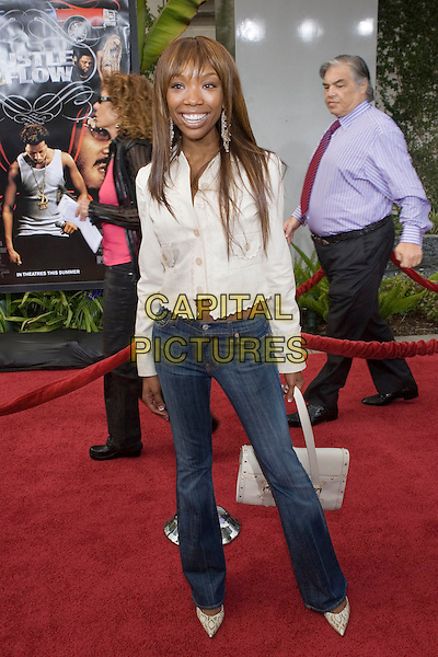 "BRANDY.At the ""Hustle & Flow"" Los Angeles Film Premiere,.held at the Arclight Cinerama Dome, .Hollywood, California, USA, 20th July 2005..full length cream jacket skinny jeans.Ref: ADM.www.capitalpictures.com.sales@capitalpictures.com.©Zach Lipp/AdMedia/Capital Pictures."