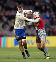 Matt Banahan of Bath Rugby fends Demetri Catrakilis of Harlequins. Aviva Premiership match, between Harlequins and Bath Rugby on March 2, 2018 at the Twickenham Stoop in London, England. Photo by: Patrick Khachfe / Onside Images