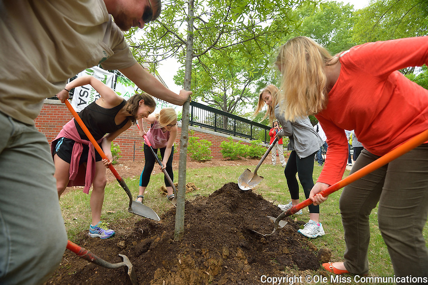 Ole Miss students (l to r) Mary Kate Robbins, Kendall McDonald, Grace Haines and Sarah Douglass help UM Landscaping Services plant a tree in front of Carrier as part of the annual Arbor Day celebration.  Photo by Kevin Bain/Ole Miss Communications
