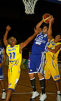 Otago's Nat Connell and Josh O'Connell try to get the ball off Kevin Owens during the NBL Basketball match between Wellington Saints and Otago Nuggets at TSB Bank Arena, Wellington, New Zealand on Sunday, 30 March 2008. Photo: Dave Lintott / lintottphoto.co.nz