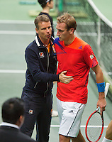 02-02-14,Czech Republic, Ostrava, Cez Arena, Davis Cup Czech Republic vs Netherlands, ,   Thiemo de Bakker (NED) (R) is comforted after his match against Berdych by captain Jan Siemerink<br /> Photo: Henk Koster