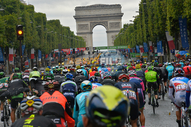 Riders approach The Arc de Triomphe on the Champs Elysees in Paris during Stage 21 of the 2015 Tour de France running 109.5km from Sevres to Paris - Champs Elysees, France. 26th July 2015.<br /> Photo: ASO/B.Bade/Newsfile