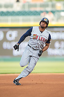 Daniel Fields (29) of the Toledo Mud Hens legs out a triple in the top of the first inning against the Charlotte Knights at BB&T BallPark on April 27, 2015 in Charlotte, North Carolina.  The Knights defeated the Mud Hens 7-6 in 10 innings.   (Brian Westerholt/Four Seam Images)