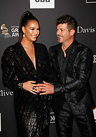 BEVERLY HILLS, CA- FEBRUARY 09: April Love Geary and Robin Thicke at the Clive Davis Pre-Grammy Gala and Salute to Industry Icons held at The Beverly Hilton on February 9, 2019 in Beverly Hills, California.      <br /> CAP/MPI/IS<br /> ©IS/MPI/Capital Pictures