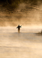 Fly Fiisherman on Madison River with early morning fog. Yellowstone National Park, Wyoming