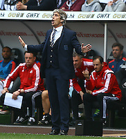 Manchester City manager Manuel Pellegrini gestures on the touchline during the Barclays Premier League match between Swansea City and Manchester City played at The Liberty Stadium, Swansea on 15th May 2016
