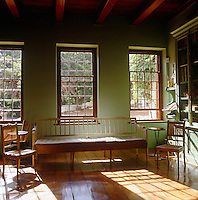 Three uncurtained sash windows ensure that the library is flooded with natural light
