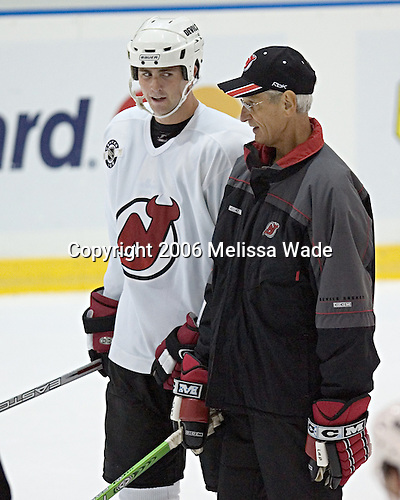Aaron Voros and Jacques Laperriere discuss a drill. The New Jersey Devils and prospects took part in their second official on-ice day of training camp on Saturday, September 16, 2006 at the Richard E. Codey Rink at South Mountain in West Orange, New Jersey.<br />