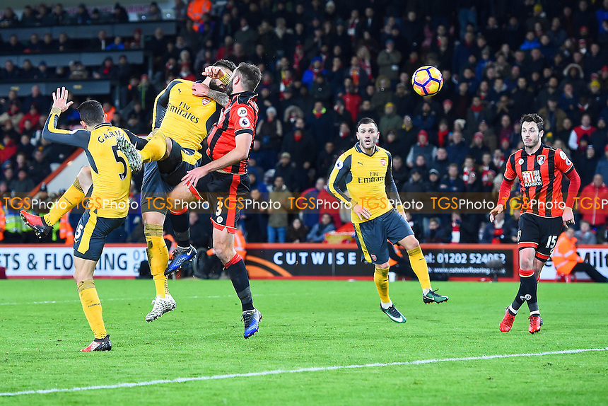 Olivier Giroud of Arsenal beats Steve Cook of AFC Bournemouth to a header to score the third Arsenal goal  during AFC Bournemouth vs Arsenal, Premier League Football at the Vitality Stadium on 3rd January 2017