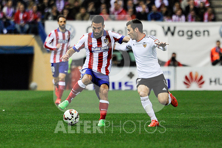 Atletico de Madrid´s Arda Turan and Valencia CF´s Sofiane Feghouli during 2014-15 La Liga match between Atletico de Madrid and Valencia CF at Vicente Calderon stadium in Madrid, Spain. March 08, 2015. (ALTERPHOTOS/Luis Fernandez)