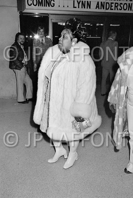 Manhattan, New York City, NY - January 28, 1974<br /> Muhammad Ali and Joe Frazier at Madison Square Garden.<br /> Billed as the &lsquo;Fight of the Century&rsquo; African-American boxing fans and dandies attended wearing the most glam-fashions of the day. Furs, minis and thigh-high platform boots were all the rage.