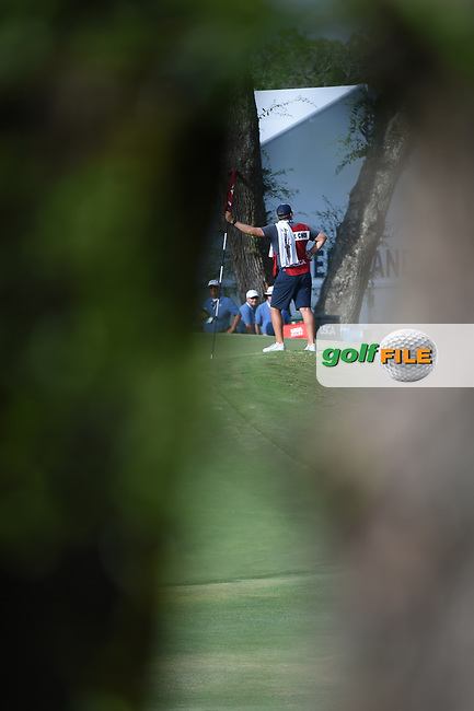 A long shot of a caddie holding a pin on the green on 11 during round 2 of the 2019 US Women's Open, Charleston Country Club, Charleston, South Carolina,  USA. 5/31/2019.<br /> Picture: Golffile | Ken Murray<br /> <br /> All photo usage must carry mandatory copyright credit (© Golffile | Ken Murray)