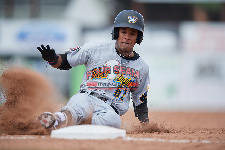 West Virginia Black Bears center fielder Michael De La Cruz (62) slides safely into third base during a game against the Batavia Muckdogs on June 25, 2017 at Dwyer Stadium in Batavia, New York.  West Virginia defeated Batavia 6-4 in the completion of the game started on June 24th.  (Mike Janes/Four Seam Images)