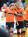 United's John Rankin is congratulated by Johnny Russell after he scores united's first    ...