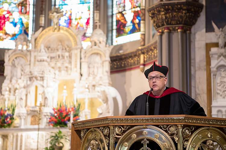 The Rev. Edward R. Udovic, C.M., secretary of the University, offers remarks during the 120th DePaul University Convocation on Thursday, August 31, 2017, at St. Vincent de Paul Parish Church. DePaul University President A. Gabriel Esteban, Ph.D.,, and Marten denBoer, provost, provided remarks, and many faculty and staff were recognized with annual awards including: Excellence in Teaching, Spirit of Inquiry, Excellence in Public Service, Vincent de Paul Professorship, Spirit of DePaul, Staff Quality Service, Gerald Paetsch Academic Advising and faculty promotion and tenure. (DePaul University/Jeff Carrion)