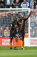 John Akinde of Barnet (right) celebrates with David Tutonda of Barnet (left) after he scores the opening goal of the game during the Sky Bet League 2 match between Barnet and Grimsby Town at The Hive, London, England on 29 April 2017. Photo by David Horn.