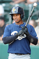 Outfielder Eduardo Sosa (2) of the Charleston RiverDogs, Class A affiliate of the New York Yankees, prior to a game against the Greenville Drive on July 31, 2011, at Fluor Field at the West End in Greenville, South Carolina. (Tom Priddy/Four Seam Images)