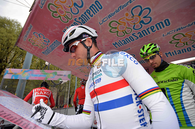 The 105th Milan–Sanremo 2014, Mark Cavendish (GBR) Omega Pharma-Quick Step and Peter Sagan (SVK) Cannondale sign on before the start of the race, Milan, Italy. 23rd March 2014.     <br /> Photo: Daniele Bottallo/LaPresse/www.newsfile.ie