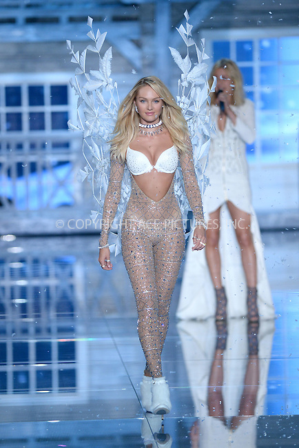 WWW.ACEPIXS.COM<br /> November 10, 2015 New York City<br /> <br /> Candice Swanepoel walking the runway at the 2015 Victoria's Secret Fashion Show at Lexington Avenue Armory on November 10, 2015 in New York City.<br /> <br /> Credit: Kristin Callahan/ACE<br /> Tel: (646) 769 0430<br /> e-mail: info@acepixs.com<br /> web: http://www.acepixs.com