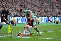 Mark Noble of West Ham United is tickled by Sead Kolasinac of Arsena during West Ham United vs Arsenal, Premier League Football at The London Stadium on 12th January 2019