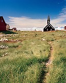 GREENLAND, Ilulissat, Disco Bay, exterior of church with field