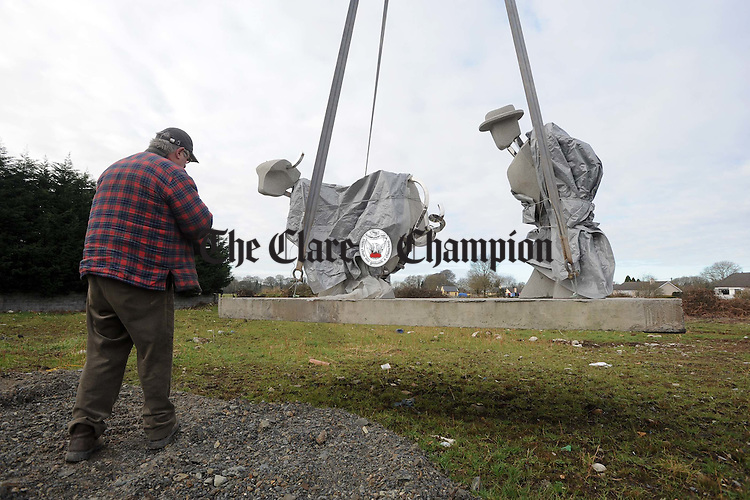 Brendan Halpin lifting Barry Wrafters Sculpture. Photograph by John Kelly.