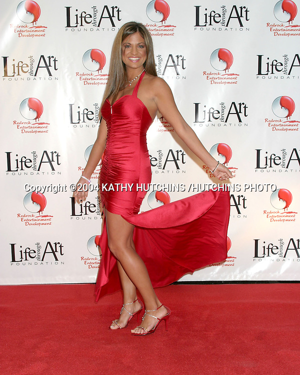 """©2004 KATHY HUTCHINS /HUTCHINS PHOTO.RED PARTY BENEFITING THE """"LIFE THROUGH ART"""" FOUNDATION.LOS ANGELES, CA.DECEMBER 4, 2004..BRIDGETTA TOMARCHIO"""