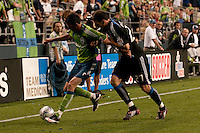 Sebastien le Toux (l) drives against Aaron Pitchkolan (27) in the Seattle Sounders 2-1 win against San Jose Earthquake on Saturday, June 13, 2009 at Quest Field in Seattle, WA.