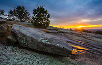 Landscape Scenic photograph of a spectacular sunset that reveals a starburst effect of light rays falling onto the summit of Stone Mountain which is located in the beautiful state of Georgia. <br />
