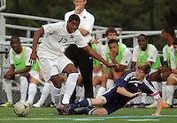 HYATTSVILLE, MD - OCTOBER 26, 2012:  Julian Dove (17) of DeMatha Catholic High School moves away from a sliding tackle by Nate Johnson (19) of St. Albans during a match at Heurich Field in Hyattsville, MD. on October 26. DeMatha won 2-0.
