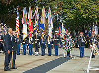 United States President Barack Obama, left, and US Army Major General Bradley A. Becker, Commander, US Army Military District of Washington, left center, stand at attention during a wreath-laying ceremony at the Tomb of the Unknown Soldier at Arlington National Cemetery in Arlington, Virginia on Veteran's Day, Friday, November 11, 2016.<br /> Credit: Ron Sachs / Pool via CNP /MediaPunch