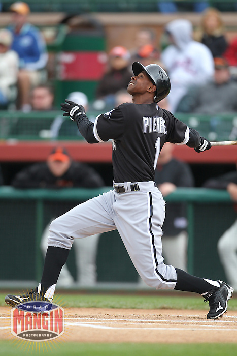 SCOTTSDALE - MARCH 9:  Juan Pierre of the Chicago White Sox bats during a spring training game against the San Francisco Giants on March 9, 2010 at Scottsdale Stadium in Scottsdale, Arizona. (Photo by Brad Mangin)