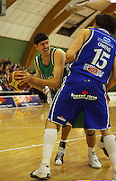 Ben Valentine looks to pass round Kevin Owens during the NBL Round 14 match between the Manawatu Jets  and Wellington Saints. Arena Manawatu, Palmerston North, New Zealand on Saturday 31 May 2008. Photo: Dave Lintott / lintottphoto.co.nz