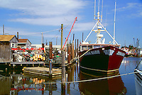 Fishing boats, docks and jetys in the tiny Raritan Bay port. Belford, New Jersey.