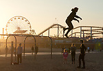 Girl practicing on tight rope at Santa Monica Beach in Los Angeles, CA