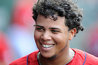 Third baseman Aneudis Peralta (28) of the Greenville Drive smiles in the dugout after scoring a run in a game against the Augusta GreenJackets on Sunday, July 13, 2014, at Fluor Field at the West End in Greenville, South Carolina. Greenville won, 8-5. (Tom Priddy/Four Seam Images)
